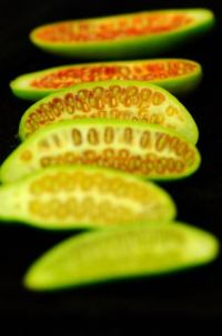Tindoori, green sliced open to show the seeds. Green and ripe are both eaten