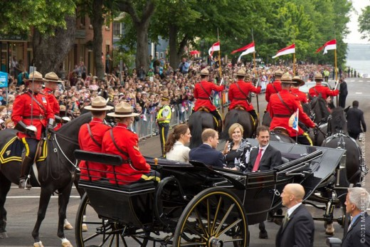 The Duke and Duchess, accompanied by the Premier of Prince Edward Island Robert Ghiz and his wife, proceed down Great George Street to Confederation Landing in Charlottetown, PEI
