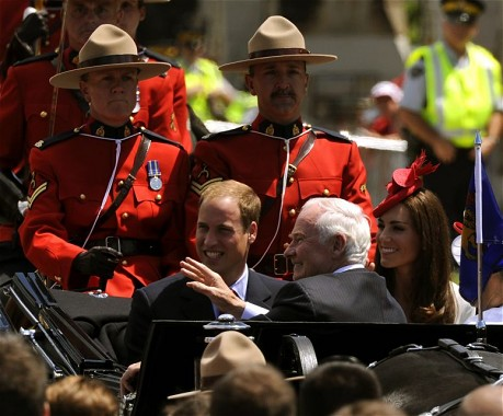 The Royal couple and the Governor General, the Right Honourable David Johnston, in the State Landau horse-drawn carriage escorted by Royal Canadian Mounted Policemen