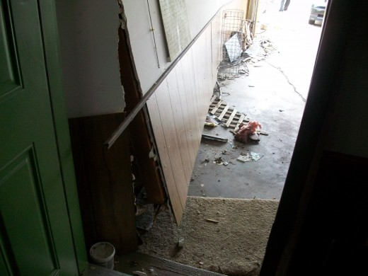 The wall between the garage and living room was sucked off the foundation.