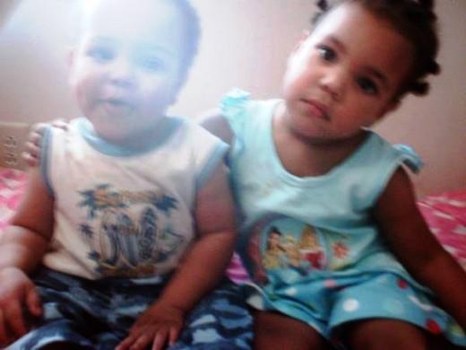 Ayden sitting with his big sister, Anaya.