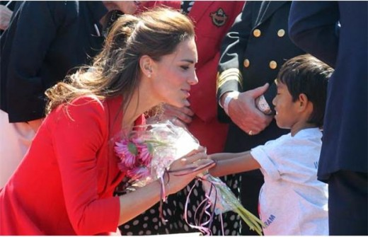The Duchess accepts flowers from Samuel Seehawer at Rotary Challenger. Samuel, adopted from Cambodia when he was 11 months old, is a victim of Agent Orange -- born without a left foot and shinbone, a left hand and a deformed right hand