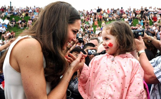Catherine greets a girl during a visit to Fort Levis in Levis, Quebec