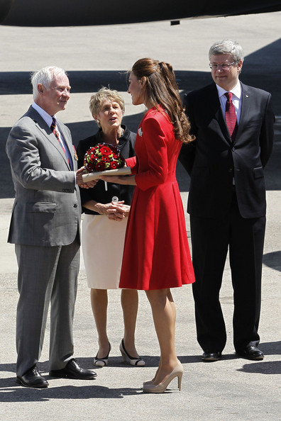 Catherine speaks to the Governor General, the Right Honourable David Johnston, and his wife, Sharon, moments before departing Calgary