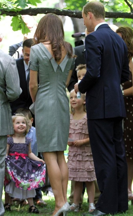 Kate Johnston-Zemek, the three-year-old granddaughter of Canada's Governor General, curtsies to the Royal couple