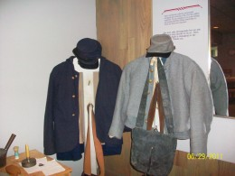 Union  and Confederate uniforms on display.
