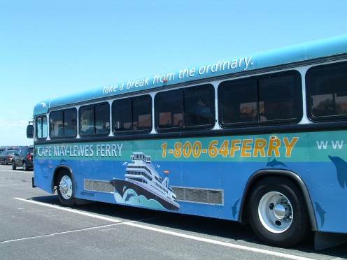Air conditioned tour bus parked at the Lewes ferry terminal ready to take passengers to the Tanger Outlets for tax free shopping.