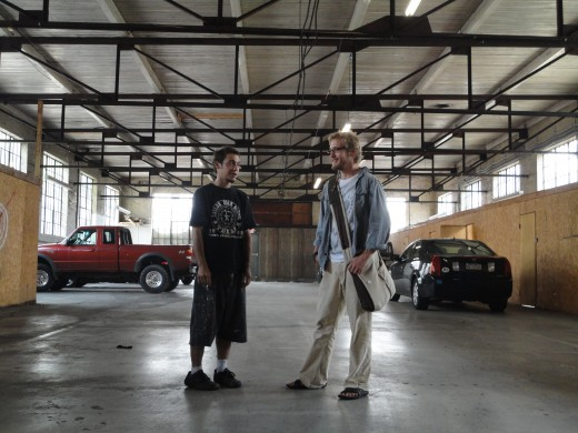 From left, image of Eric Stahl and Chris Lauer inside of a parking garage in Gettysburg, Pa.  The garage housed several art shows.