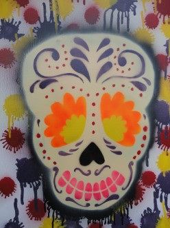 Image of skull painting using spray paint and stenciling techniques by Kyle Maier
