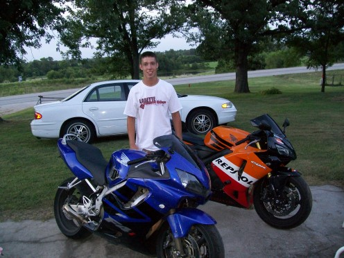 His first motorcycle, the blue one and his first  Repsol.