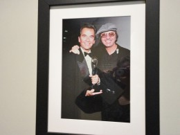 A wall portrait of American Bandstand's host Dick Clark with Dion of the Belmonts.
