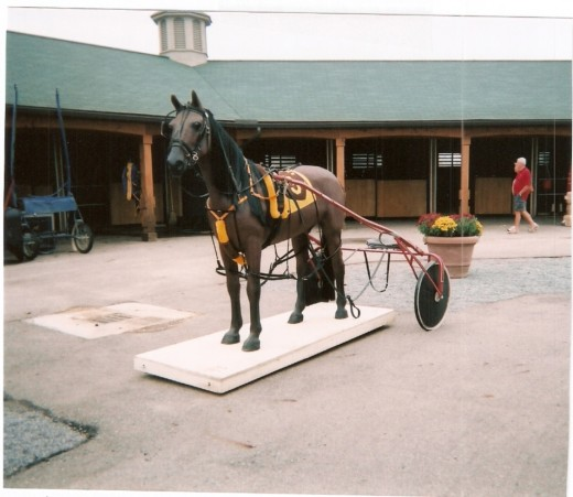 This statue in the Jugette barn on the Delaware, Ohio, County Fairgrounds honors America's great Standardbreds.