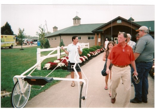 John Campbell moves a sulky from Barn 40A at the Delaware County Fairgrounds. Campbell is an all-time wins leader in Standardbred racing.