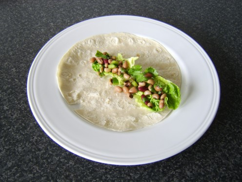 This Mexican style three bean salad is excellent in a tortilla wrap, placed firstly on a bed of lettuce leaves