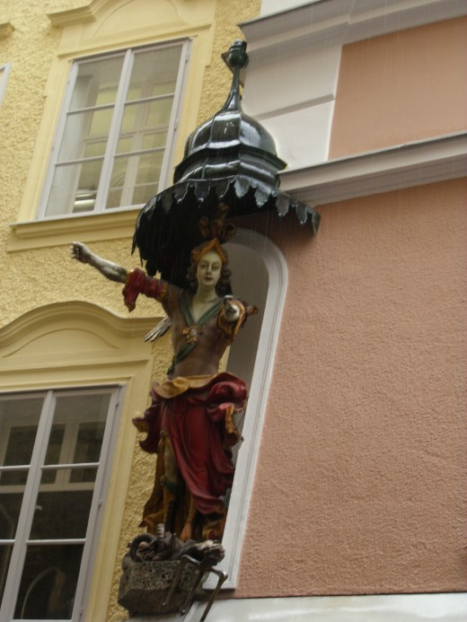 Statue on the wall of Hotel  Altstadt, Salzburg, Austria