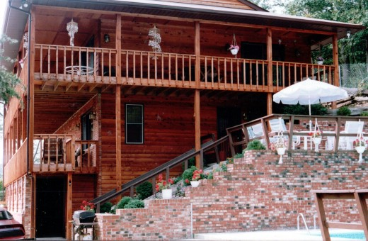 Side view of my childhood home, which overlooked Valentine Creek.  Note the seashell windchimes hanging from the porch.