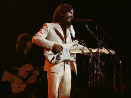 "Harrison's infamous white suit featured stiched ""Om"" symbols in the suit's collar."