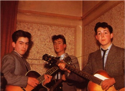 Young George (far left), John (center) and Paul (right) practicing for a gig as the Quarrymen.