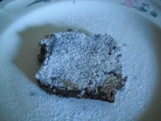 Basic chocolate brownie dusted with powdered sugar