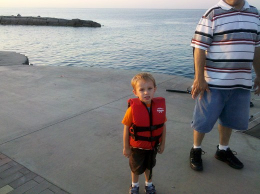 Isn't he adorable in that little life jacket?