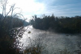 Morning steam rising off the river.
