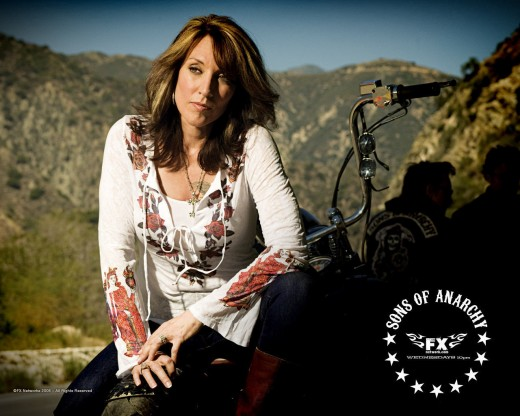 "Gemma Teller-Morrow is played by Katey Sagal(Peg Bundy from the hit show: Married with Children) is the mother of Jax and the ""Queen"" of the SOA club."