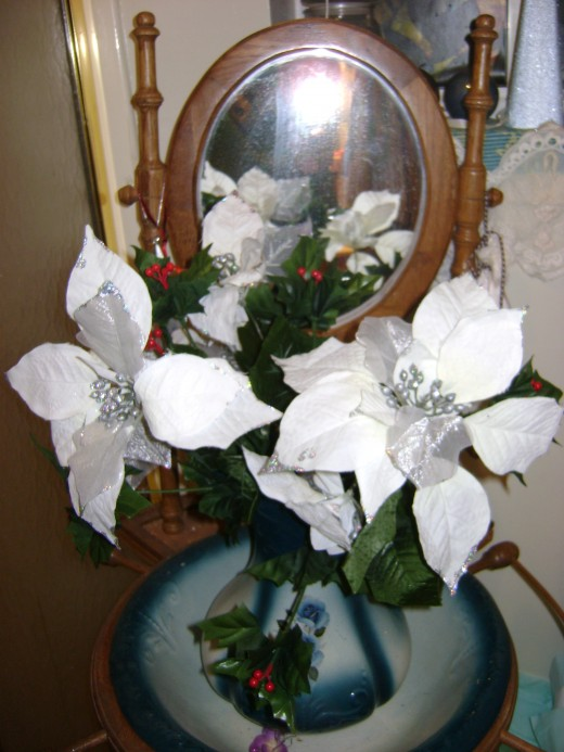 Washstand in the bathroom, white poinsettias