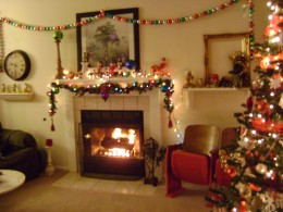 Mantle decorated with an Ornament garland and lights