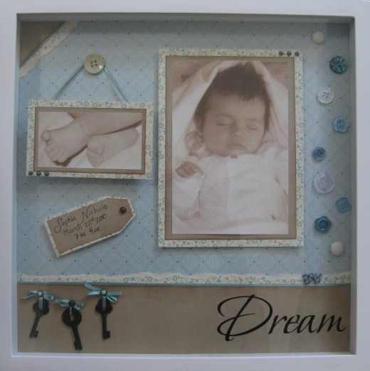 A framed scrapbook page makes beautiful and personal gifts.