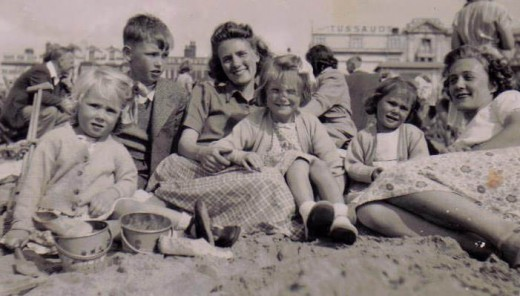 My sister, cousins, Aunt, Mum and me on Blackpool beach in 1948. Tussauds Waxworks is in the background.