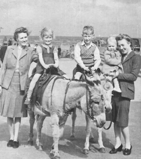 Blackpool donkeys 1947. My cousins are on the donkeys. Mum and Aunt wearing suits - no such things as holiday clothes.