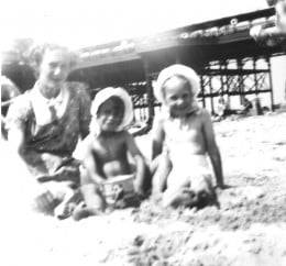 With mum on Blackpool beach. We always wore our sun bonnets on sunny days