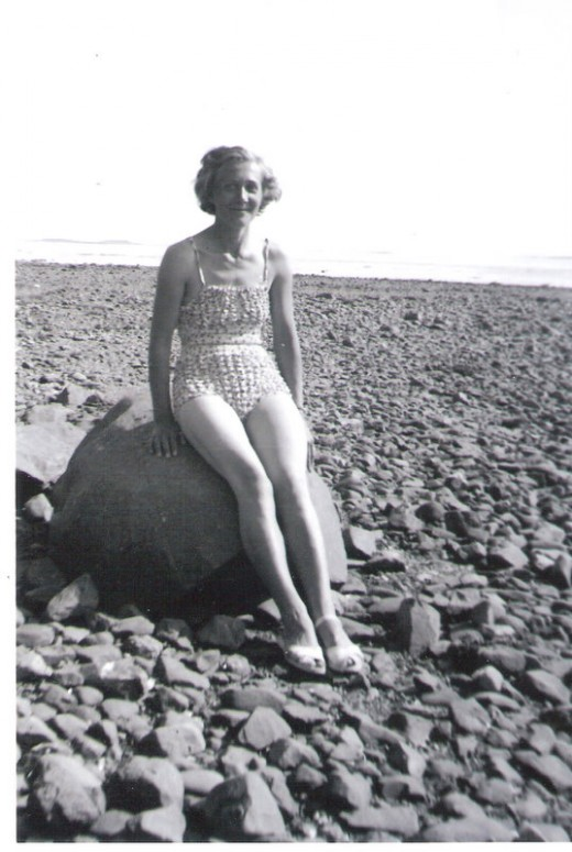 Mum wearing a bubble effect swimsuit made out of fine cotton which has been stitched with shirring elastic in a criss cross fashion. One size fits all! Photo not taken in Blackpool - Blackpool has sandy beaches.