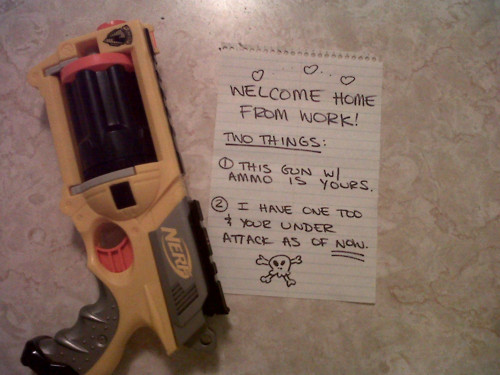 This is a picture of a nerf gun. The girlfriend set this up while the boyfriend was at work.