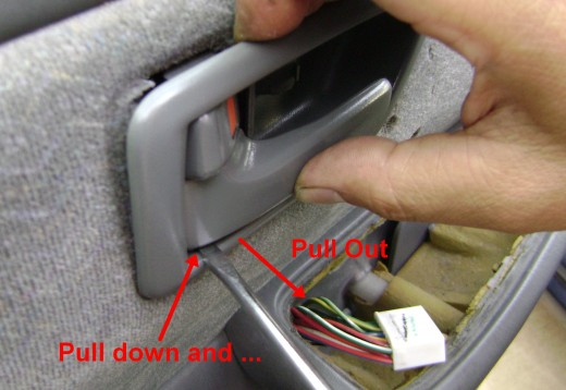 Push down on the lower Handle Bezel and pull to release the lower connection