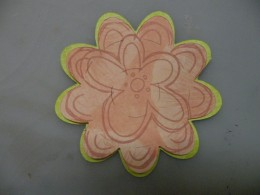 Smaller flower stamped and adhered to larger flower
