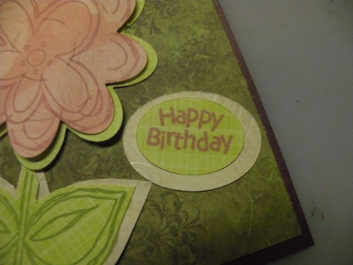 Happy Birthday stamped on small oval