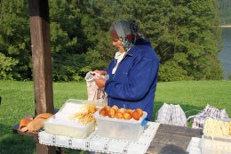 A Polish grandmother selling her own smoked cheese made with salted sheep's milk.