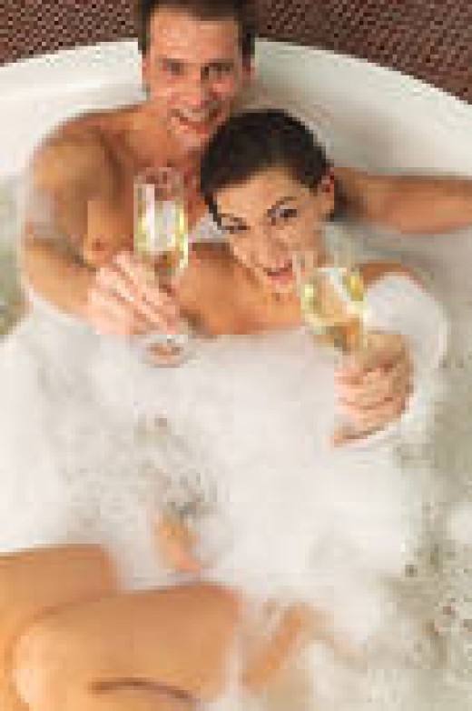 An ideal man can, at anytime, just wink and beautiful girls flock to his side. And having vintage champagne with a lovely girl in a tub of bubble bath is just a daily event for the ideal man.