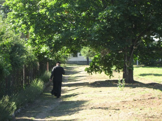 A monk taking a stroll inside St. George's Monastery in Veliky Novgorod, Russia