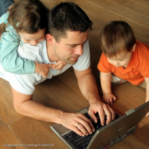 Working At Home With His Kids