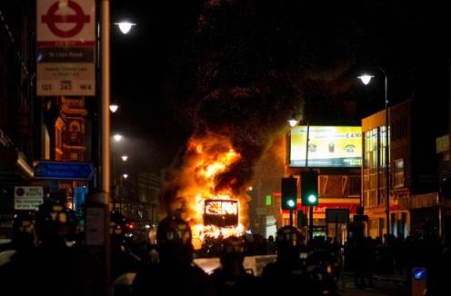 A double-decker bus on fire.