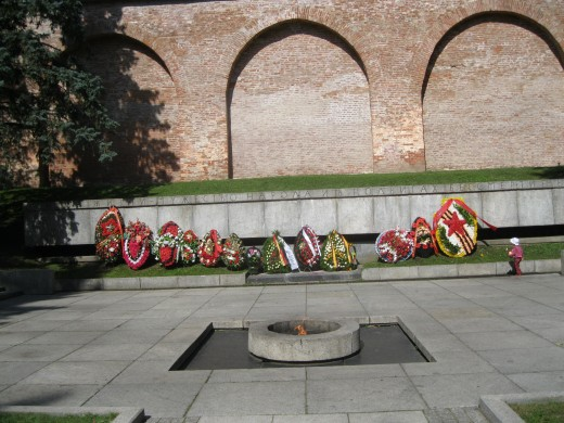 Eternal Flame in front of World War II War Memorial located along east wall inside Kremlin in Veliky Novgorod, Russia