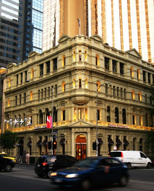 Louis Vuitton store on Collins Street in Melbourne. The amazing contrast between Victorian Era architecture and modern skyscrapers in the background