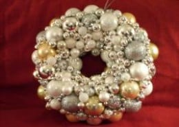 """This silver and gold ornament wreath will fit with any decor. It was only 20"""" in diameter."""