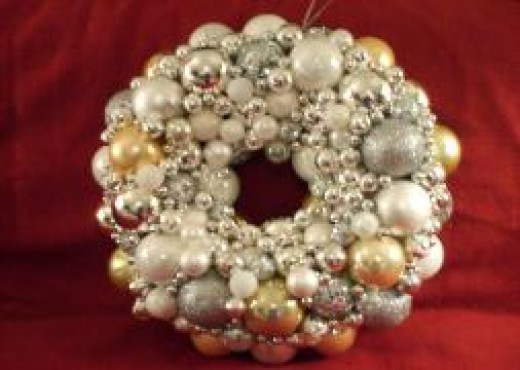 "This silver and gold ornament wreath will fit with any decor. It was only 20"" in diameter."