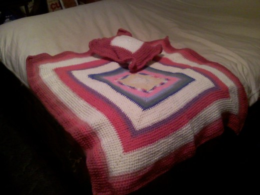 Crocheted blanket and pillow