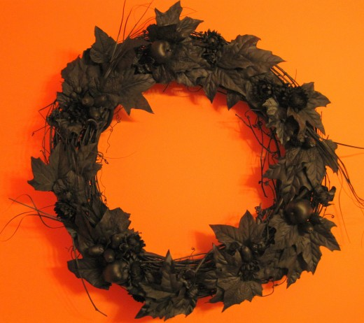Black Halloween Wreath - crafted from existing fall wreath spray painted black.