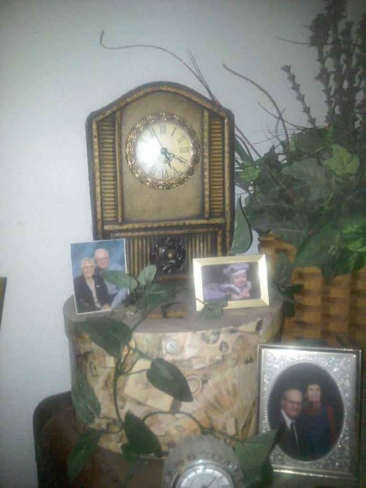 A hat box not only protects and preserves a hat, but it placed under a clock, it becomes part of the decor of the room.