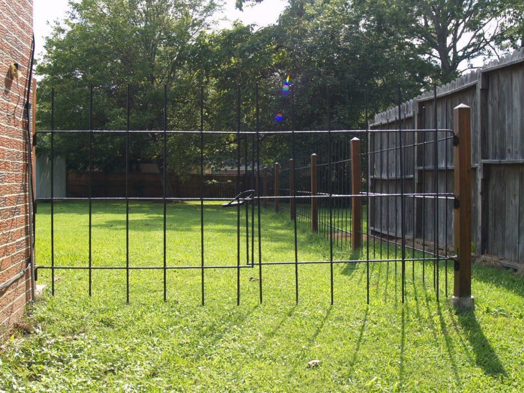 Build a decorative metal rebar fence for your home for less than seven dollars per linear foot - Build wire fence foundation ...